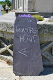 Treasure hunt sign. On the stone Royalty Free Stock Image