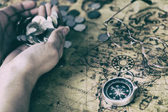 Treasure hunter with hand full of coin. Treasure hunter map with hand full of coin Stock Image