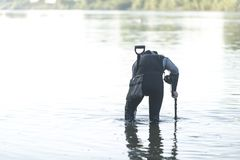 Treasure hunter is looking for a metal detector in the river. Treasure hunter treasure hunter is looking for a metal detector in the river Stock Images