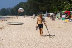Treasure hunter with Metal detector on the beach. A treasure hunter with Metal detector on the beach Stock Photo