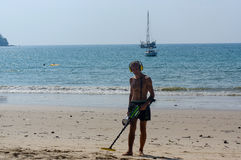 Treasure hunter with Metal detector on the beach. A treasure hunter with Metal detector on the beach Stock Photos