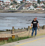 Treasure hunter. Photo of a treasure hunter using a metal detector on the beach in kent. photo taken 24th sept 2015 ideal for hobbies,active life,treasure etc royalty free stock photography