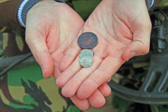 Treasure hunter. Searching with metal detector. Old Coins in hand Stock Image
