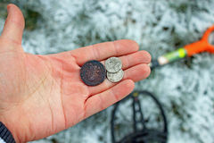 Treasure hunter. Searching with metal detector. Old Coins in hand Royalty Free Stock Photos