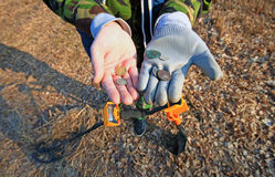 Treasure hunter. Searching with metal detector. royalty free stock photo