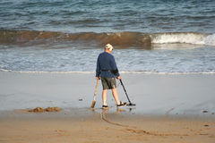 Treasure Hunting. Man searching for treasures at the end of the day Stock Photo
