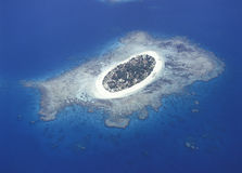Treasure island. Aerial view of the Fiji island, Treasure island surrounded by a coral reef royalty free stock images