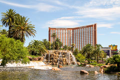 Treasure Island Hotel & Casino in the Las Vegas Strip. LAS VEGAS, NEVADA - July 13, 2014 - Treasure Island Hotel & Casino and Hotel Mirage's lake and volcano Stock Image