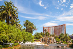 Treasure Island Hotel & Casino in the Las Vegas Strip. LAS VEGAS, NEVADA - July 13, 2014 - Treasure Island Hotel & Casino and Hotel Mirage's lake and volcano Royalty Free Stock Photography