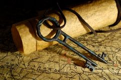 Treasure Key. Photo of Vintage Maps and a Tresure Chest Key - Exploration Concept Royalty Free Stock Image