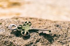 Treasure key lost on rock at the beach Stock Photography