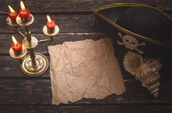Treasure map with copy space mock up. Pirate table. Blank crumpled paper page with copy space for pirate treasure map on captain table with pirate hat, seashell royalty free stock photos