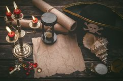 Treasure map with copy space mock up. Pirate table. Pirate captain table with crumpled paper page with copy space for treasure map, golden compass, sand watch stock images