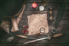 Treasure map with copy space mock up. Pirate table. Pirate captain table with crumpled paper page with copy space for treasure map, golden compass, sand watch stock photography