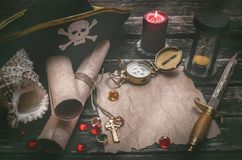 Treasure map with copy space mock up. Pirate table. Pirate captain table with crumpled paper page with copy space for treasure map, golden compass, sand watch stock photos