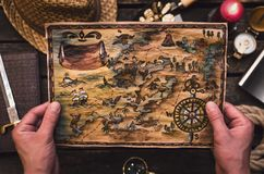 Treasure map in adventurer treasure hunter hands. stock photos