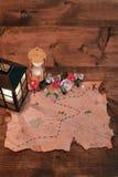 Treasure map and lantern Stock Photo