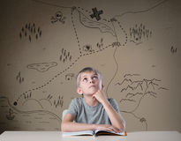 Treasure map. Little kid thinking about treasure map from his adventure book Stock Images
