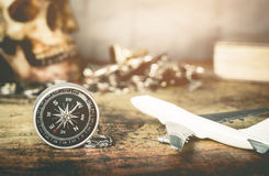 Treasure Pirate style vintage travel adventure accessories. On vintage map Royalty Free Stock Photos