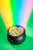 Treasure: Rainbow Leads To Pot Of Shamrock Coins Royalty Free Stock Photography