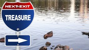 Treasure road sign. With duck and lake background stock footage