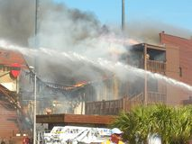 Fire building Ship Restaurant panama city beach florida stock images