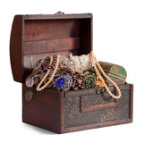 Treasure trunk. Wooden treasure trunk with jewellery, isolated over white background Royalty Free Stock Images