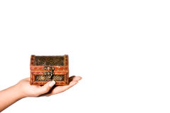 Treasure in your hand. Hand holding a small treasure chest Royalty Free Stock Photo
