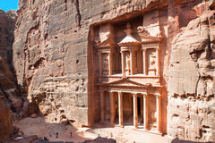 Treasury (Al-Khazneh) in ancient city of Petra in. Treasury (Al-Khazneh) in ancient city of  Petra in Jordan. It was carved out of a single rocks. It is now an Royalty Free Stock Photography