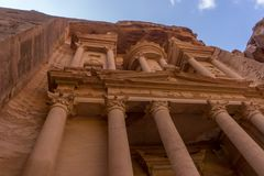 The treasury Al Khazneh carved into the rock at Petra, Jordan. Petra is one the New Seven Wonders of the World Royalty Free Stock Images