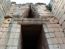 Treasury of Atreus tholos tomb. The Treasury of Atreus or Tomb of Agamemnon is an impressive tholos tomb at Mycenae, Greece (on the Panagitsa Hill) constructed Royalty Free Stock Photo