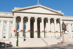 Treasury Building Decorated Christmas Red Bows DC. Treasury building in Washington DC decorated for Christmas.  String of pine garlands with red bows attached to Stock Image