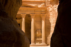 The Treasury at Petra. The Treasury seen through the Siq, a narrow canyon path through high rock cliffs, at Petra Royalty Free Stock Photos