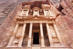 The Treasury in Petra - Jordan. The Treasury (Al Khazneh) early morning in the ancient town of Petra (an UNESCO World Heritage Site) in Jordan (Arabia / Middle Stock Image