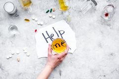 Treat alcohol dependence. Words Help me near glasses, bottles and pills on fgrey background top view copy space. Treat alcohol dependence. Words Help me near Royalty Free Stock Photo