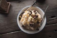A treat. Thai local dessert made from cereal, thai-tea, and crushed ice sold at Hue ta kae, ladkrabang, bangkok thailand Royalty Free Stock Photos