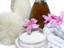Treat yourself. Spa towel and lotions for the body Royalty Free Stock Photos