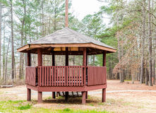 Treated Lumber Gazebo. Treated redwood lumber gazebo in green park Stock Photo