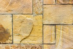 Treated natural stone. Not smooth rough surface of solid natural material. Background sandstone.  royalty free stock image