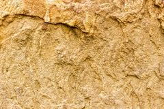 Treated natural stone. Not smooth rough surface of solid natural material. Background sandstone.  royalty free stock photo