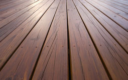 Treated pine decking. Planks of pine decking treated with deck oil Stock Image