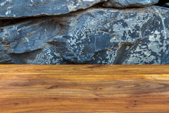 Treated reddish brown wood timber with exotic natural stonewall Stock Images