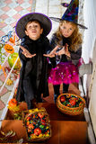 Treaters child. Happy children in a costumes of witches and wizards celebrating halloween. Trick or treat. Halloween party Stock Images