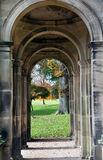 Treatham gardens old building ruin. Countryside view through arch pillars royalty free stock photo