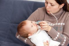 Treatment of the common cold in baby stock photography