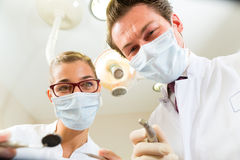 Treatment at dentist from perspective of patient Royalty Free Stock Photo
