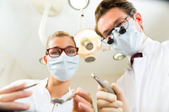 Treatment at dentist from perspective of patient Stock Photos
