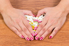 Treatment of diseases with modern methods. Homeopathic and chemicals. Various kinds of drugs in female hands. Stock Images