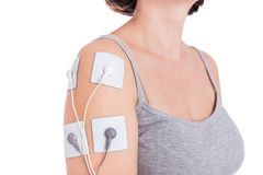 Treatment electrostimulator shoulder. Stock Photography