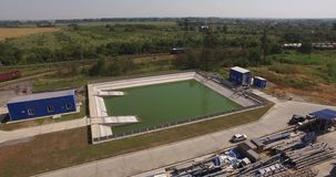 Treatment facilities at the plant,view from above. Waste water treatment system at the metallurgical plant, cleaning pool, purification circuit, treatment stock video footage